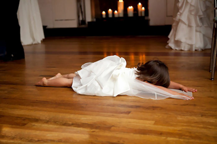 kid laying on the floor during a wedding