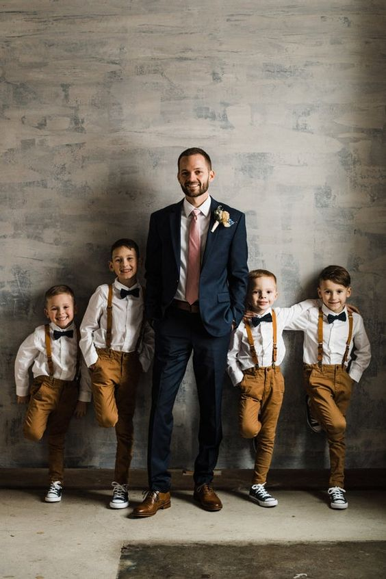 photo of the groom with his sons on the wedding day